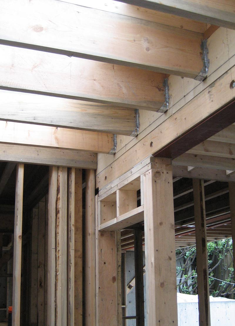 door-header-made-up-of-a-steel-beam-with-beam-casing-in-place-with-floor-joists-attached-with-hangers-stud-framed-wall