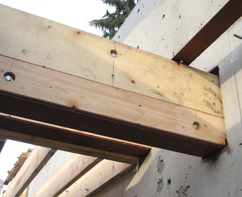 steel+beam-back+framing-connection-to-concrete+wall