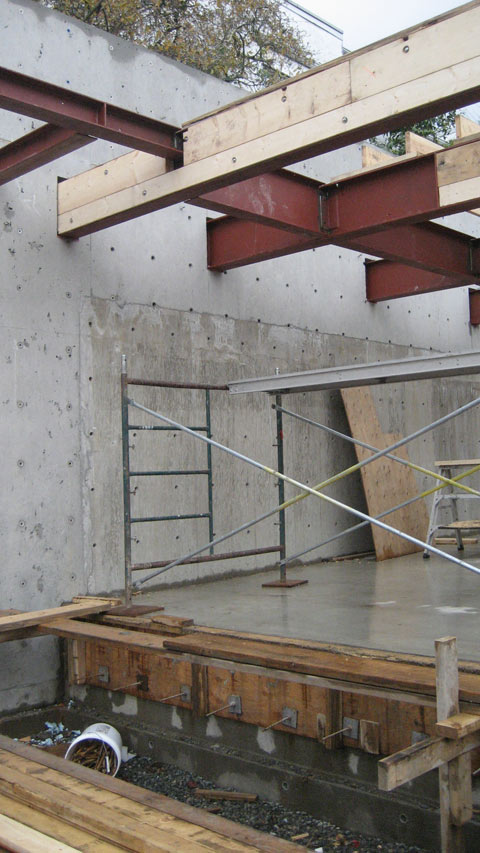 steel+beams-sitting-in-concrete+wall-pockets