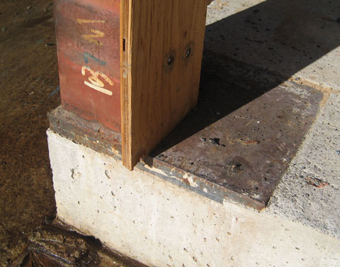steel+column-welded-to-baseplate-embedded-in-concrete+foundation+wall