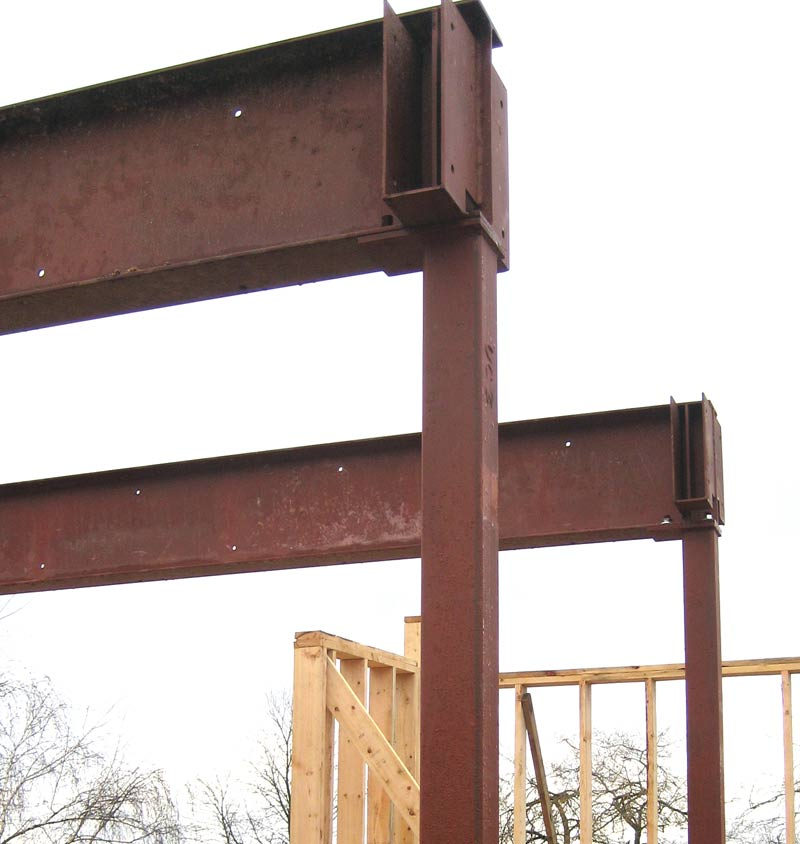 steel-beam-and-steel-column-connection-steel-saddles-prepped-up-for-LVL-beams-bolted-connection-between-column-and-steel-beam