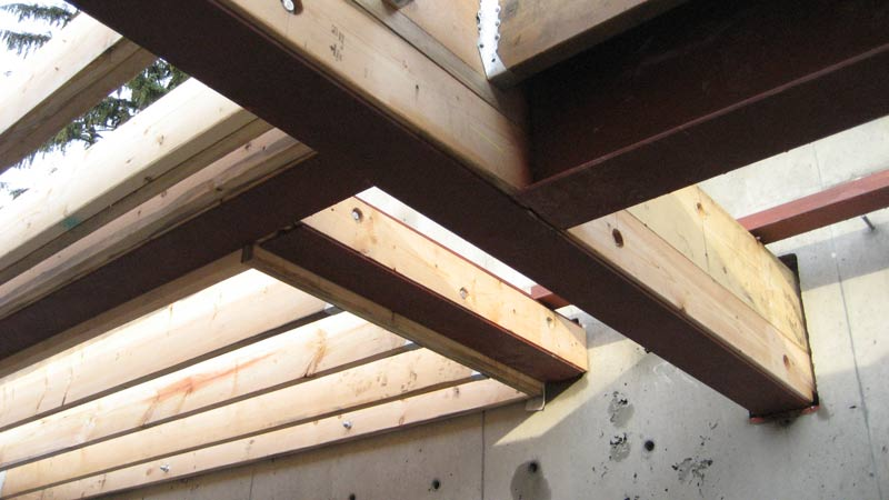 steel-beam-casing-attached-wth-bolts-steel-beams-attached-to-concrete-wall