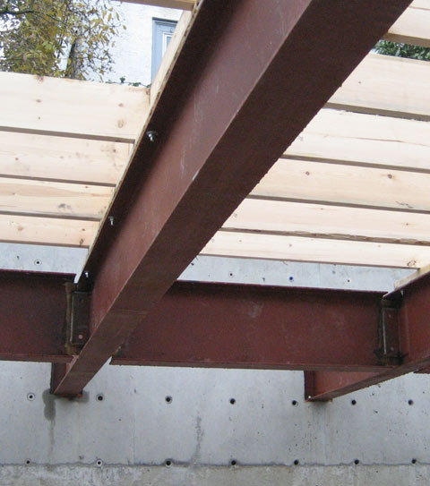 steel-beam-to-concrete+wall-connection-with-top+plate-and-wood-floor+joists-steel+connection