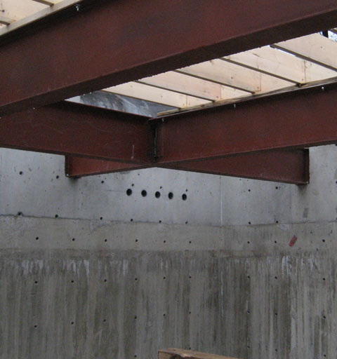 steel-beam-to-concrete+wall-connection-with-top+plate-and-wood-floor+joists