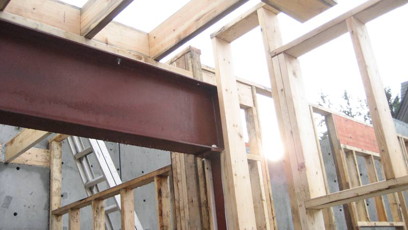 stud-wall-framing-around-steel-frame