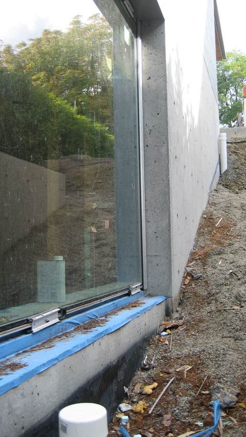 window-sill-at-sunken-garden-peel-and-stick-concrete-wall-inset-window