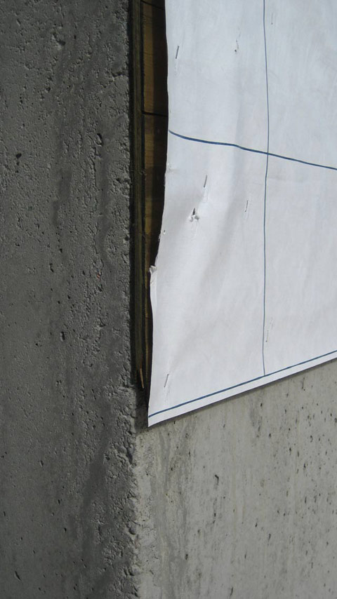 Tyvek membrane over pressure treated plywood and concrete wall