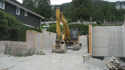 backhoe-in-foundation-wall
