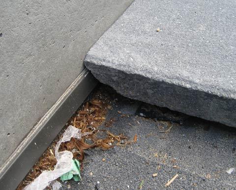 concrete-paver-over-waterproofed-concrete-q-deck-at-concrete-wall