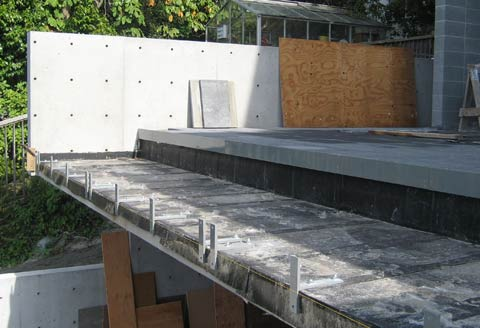 waterproofing-over-cantilevered-slab-metal-attachments-at-slab-edge-for-grass-guard