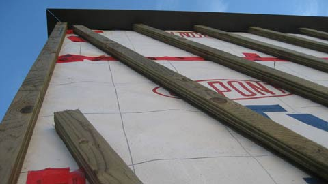 diagonal-strapping-over-tyvek-pressure-treated