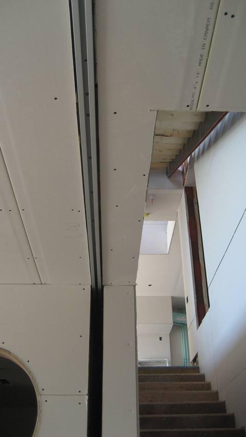 pocket-door-rail-drywall-before-mudding