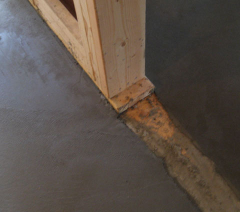radiant-floor-poured-against-framed-stud-wall-sill-plate
