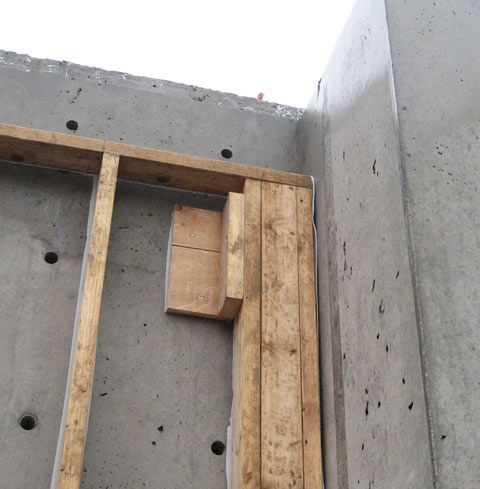 stud+wall+framing-at-concrete_wall