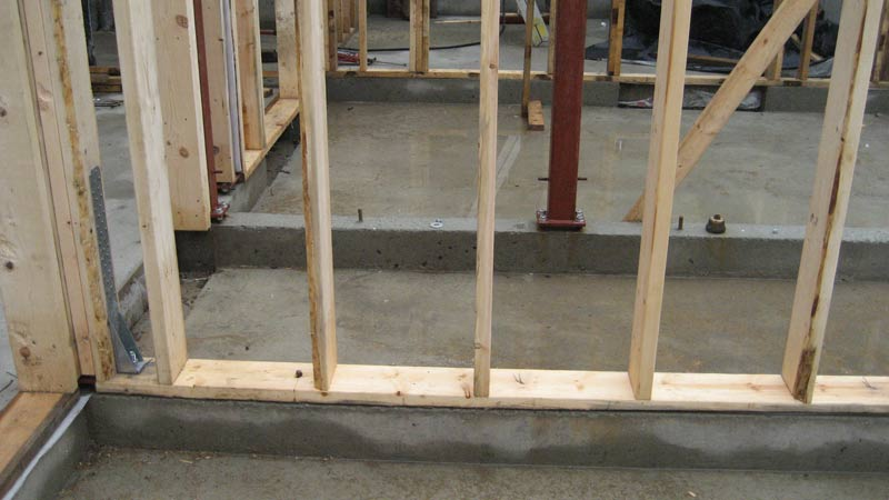 stud-wall-framing-over-concrete-foundation-walls-wood-