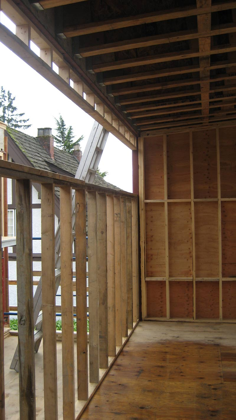 window-framing-with-studs-TJI-roof-framing-above-plywood-sheathing-applied