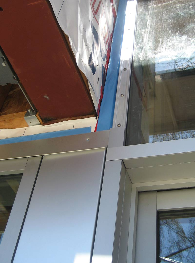 anodized-aluminum-window-and-door-frame-with-breakshabe-between-at-soffit