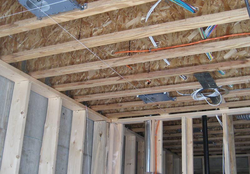 Structure stud wall home building in vancouver for Floor joist construction