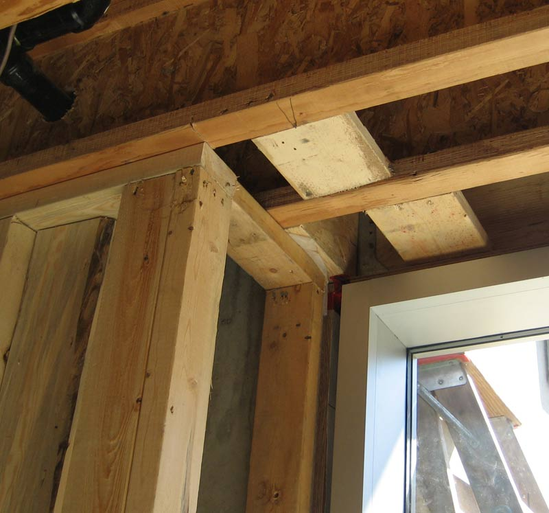 stud-wall-framing-around-concrete-foundation-wall-corner