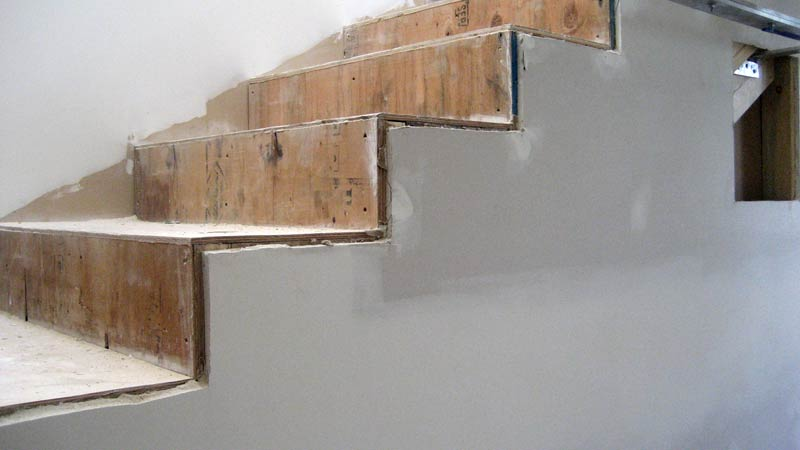 DRYWALL-OVER-THE-SIDE-OF-INTERIOR-STAIR-FRAMING