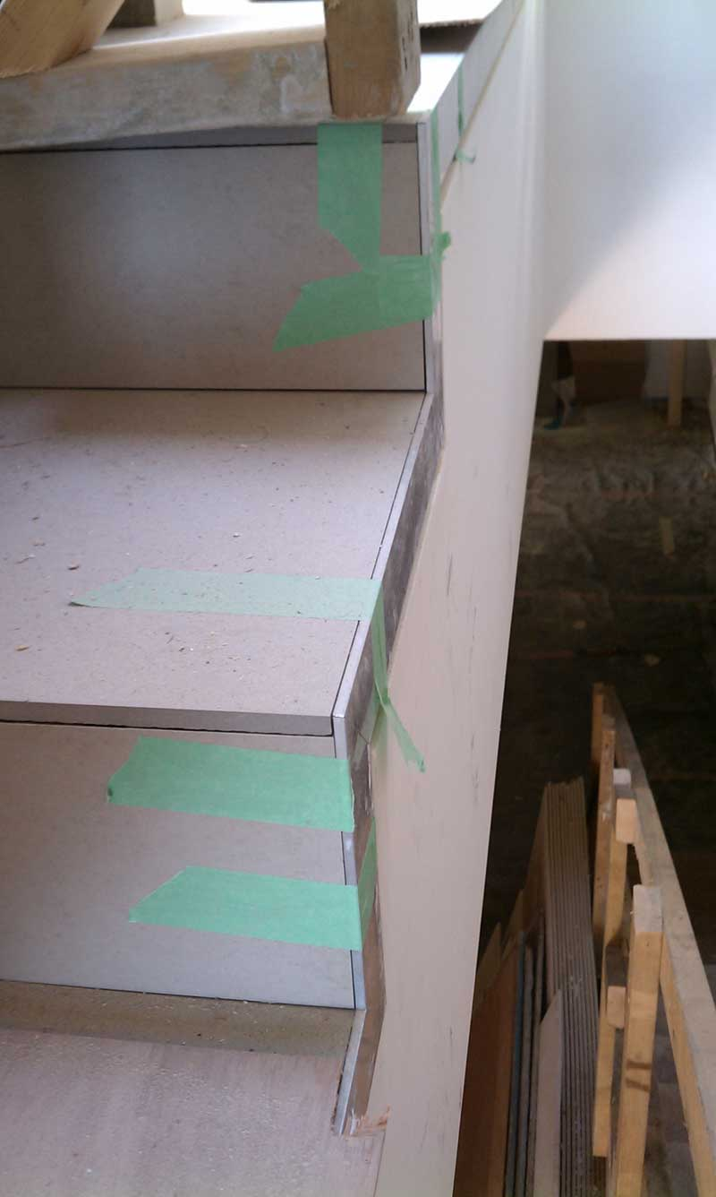 FLOOR-TILE-ON-STAIR-AND-ALUMINUM-TRIM