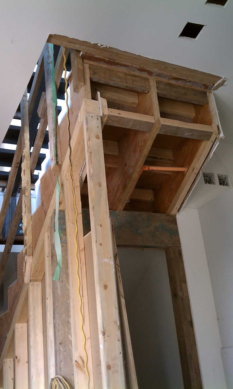 INTERIOR-WOOD-STAIR-FRAMING-STAIR-STRINGER-AND-STORAGE-UNDER-STAIR