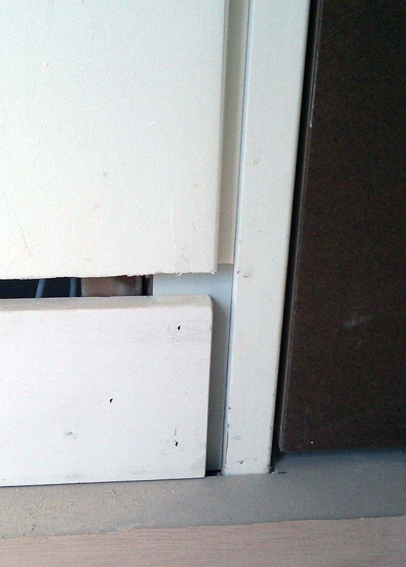 MDF-BASEBOARD-AND-DRYWALL-AT-DOOR-FRAME--BEFORE-SHADOW-BEAD-INSTALLATION