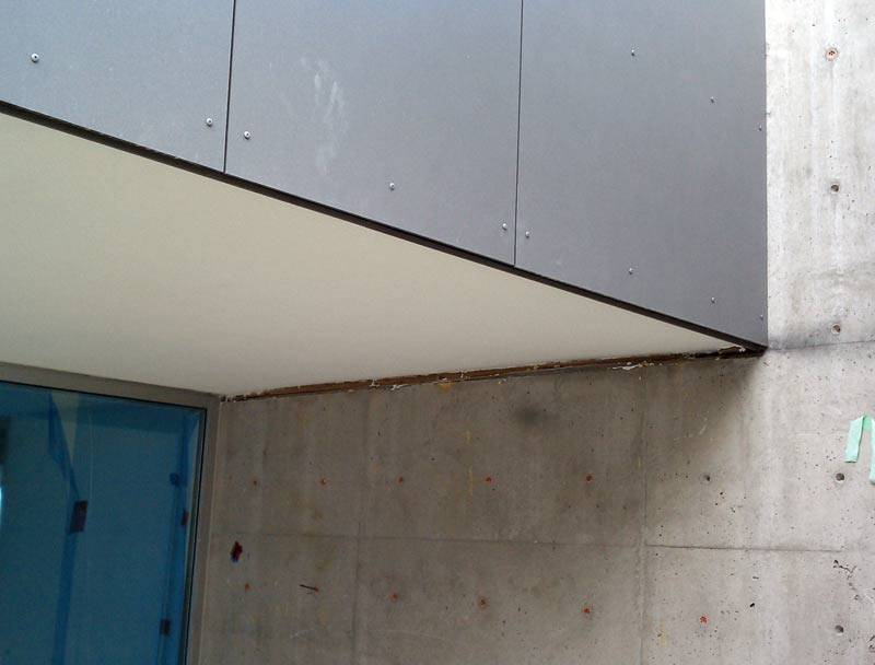 SWISS-PEARL-CEMENTITIOUS-PANEL-AT-STUCCO-SOFFIT-AND-CONCRETE-WALL