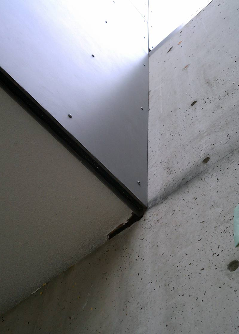 SWISS-PEARL-CEMENTITIOUS-PANEL-CLOSEUP-DETAIL-AT-CONCRETE-WALL-AND-STUCCO-SOFFIT-JUNCTION