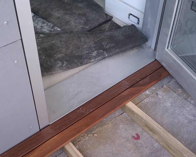 WOOD-DECK-AT-STAINLESS-STEEL-DOOR-SILL