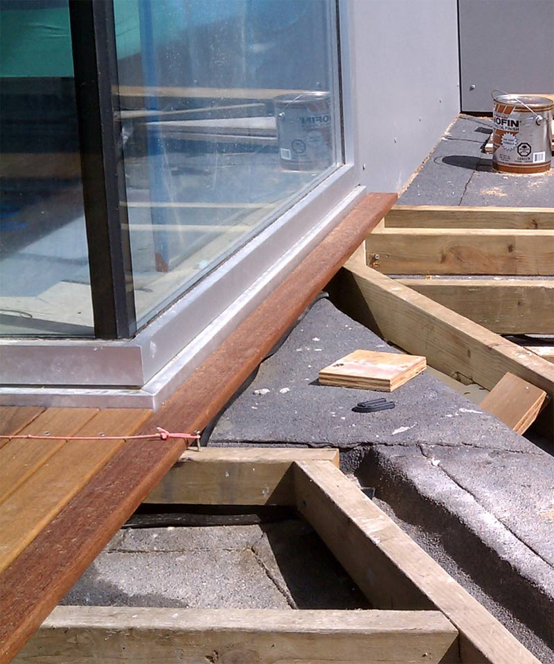 WOOD-DECK-AT-WINDOW-FLASHING-OVER-PRESSURE-TREATED-SLEEPERS-AND-SBS-MEMBRANE