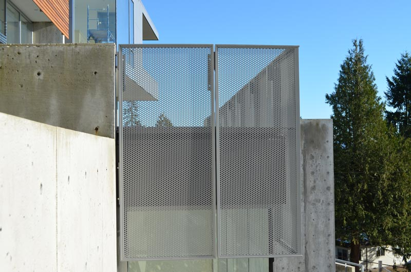 mesh-screen-guard-attached-off-pool-deck-at-concrete-wall
