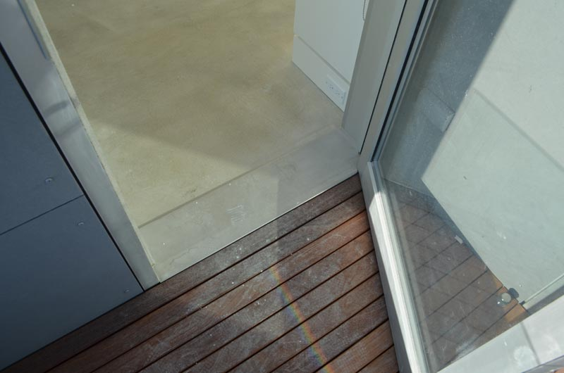 stainless-steel-threshold-at-wood-deck