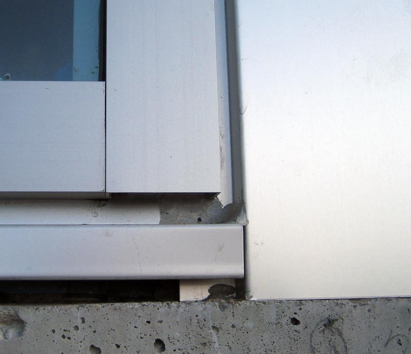 exterior-curtain-wall-detail-flashing-at-concrete-and-side-aluminum-panel