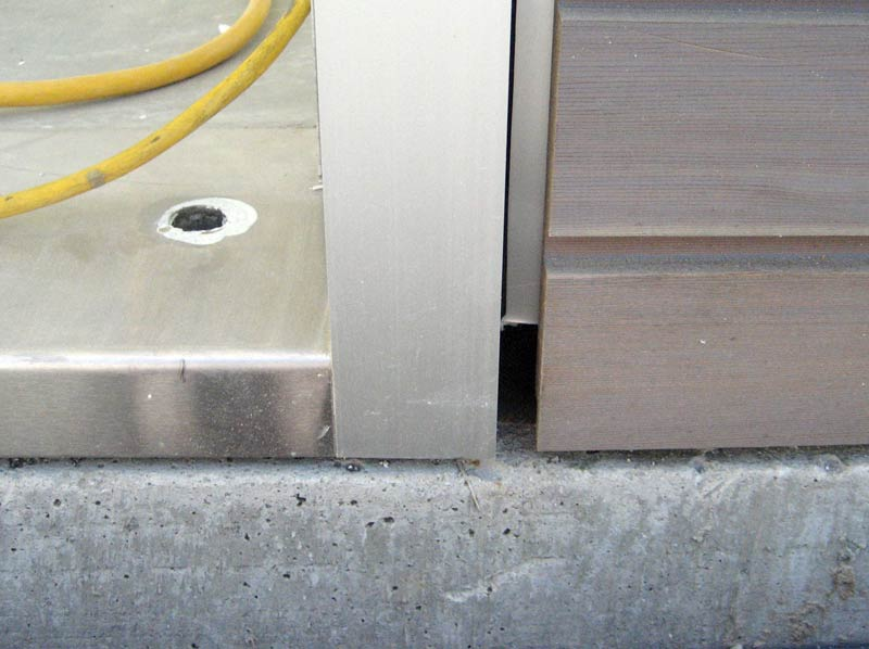 CUSTOM-STAINLESS-STEEL-DOOR-THRESHOLD-OVER-CONCRETE-FOUNDATION-WALL-PLUS-ALUMINUM-FLASHING-AT-HORIZONTAL-WOOD-SIDING-