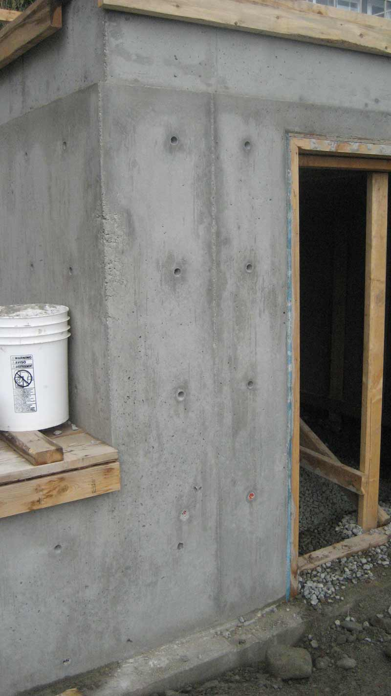 West van concrete walls home building in vancouver for Door in the wall