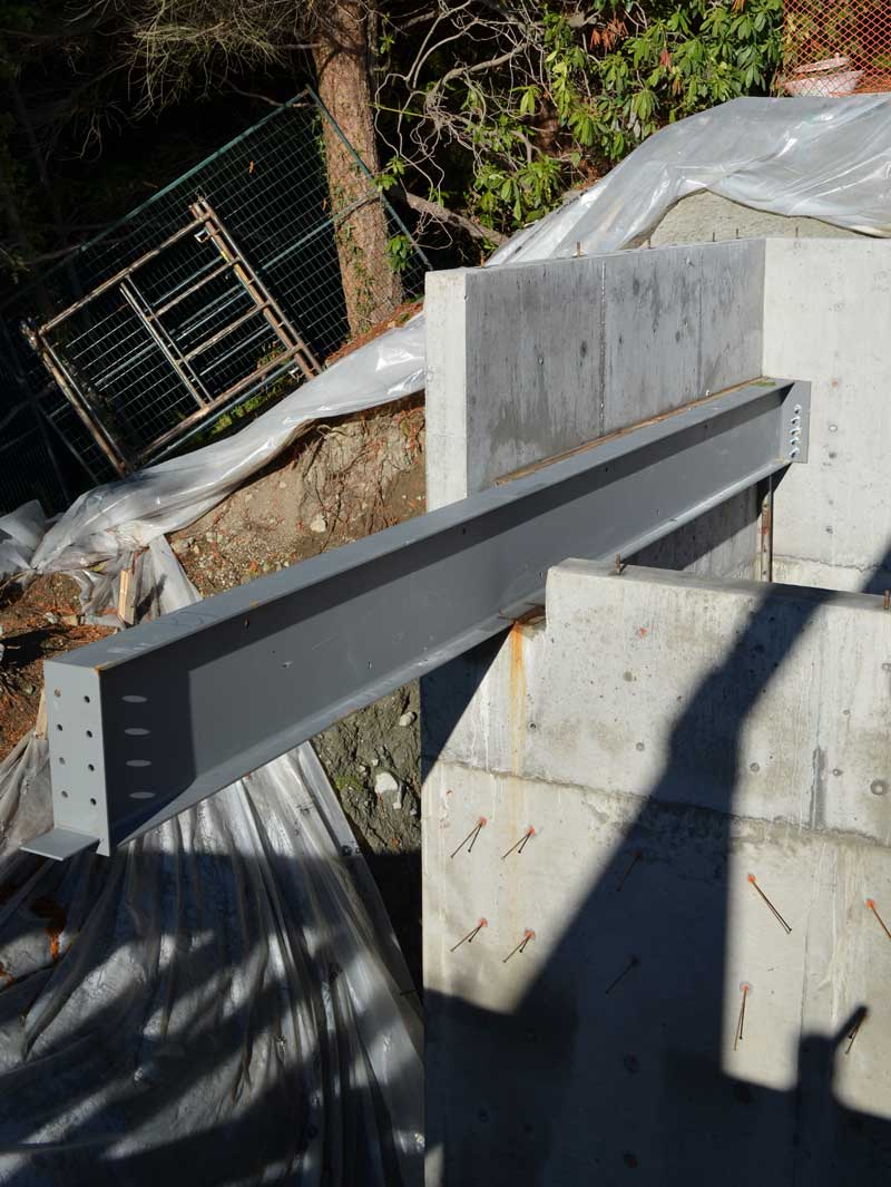 cantilevered-steel-beam-over-concrete-wall