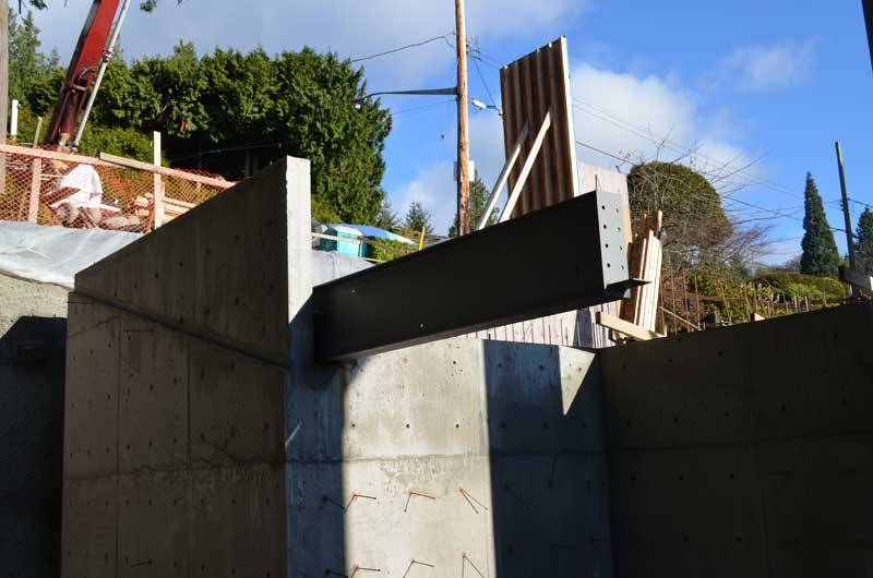 deep-steel-i-beam-cantilevered-over-concrete-wall