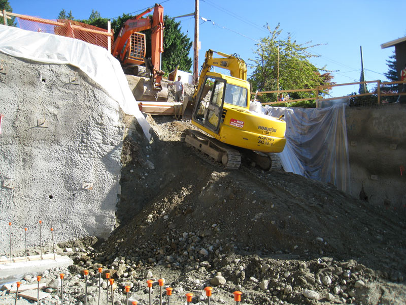 excavator-backlhoe-next-to-shotcrete