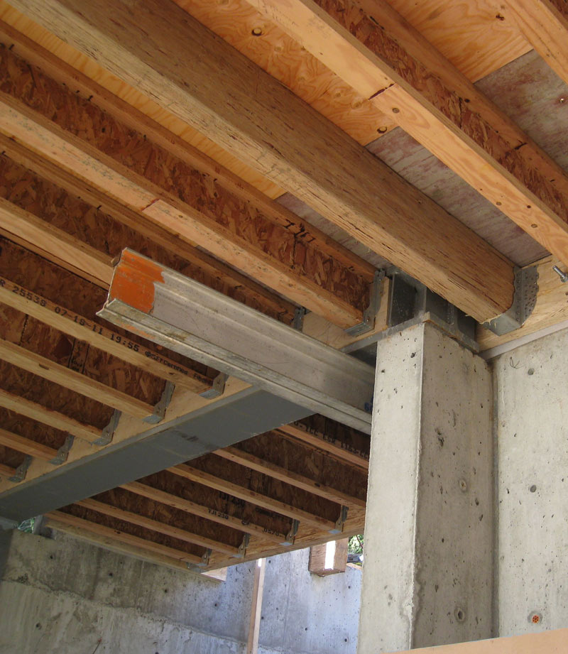 steel-beam-over-concrete-pilaster-with-TJI-framed-floor
