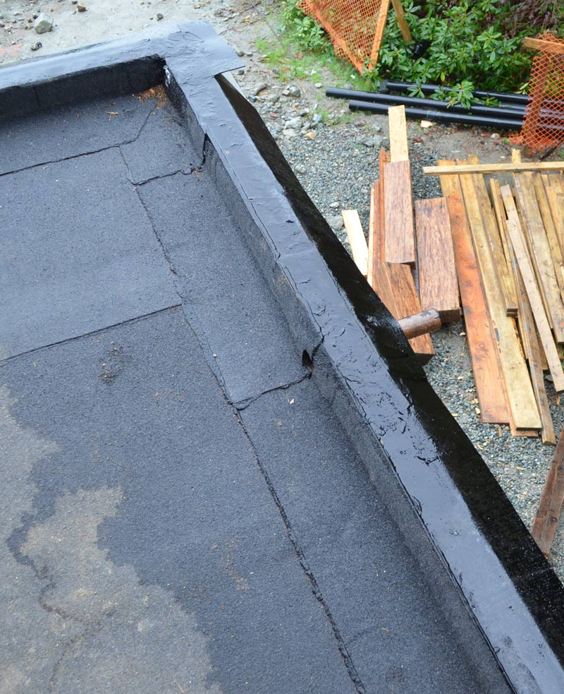 DECK-SBS-MEMBRANE-WATERPROOFING-OVER-CURB-PLUS-OVERFLOOW-SCUPPER