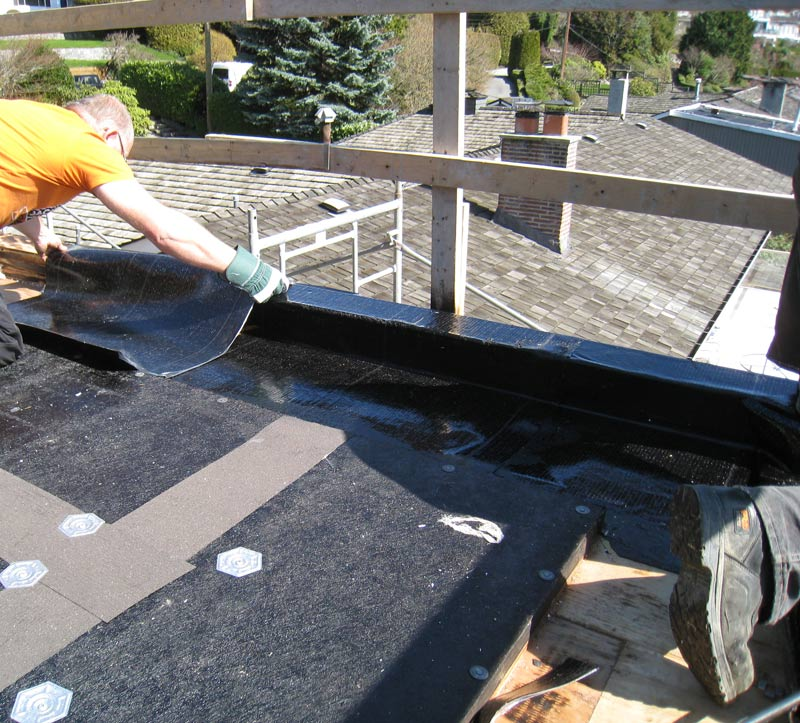 ROOF-MEMBRANE-APPLIED-OVER-PERIMETER-CURB-AND-TROUGH-DRAIN