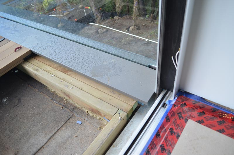 WOOD-DECK-OVER-SLEEPERS-AT-GLASS-GUARD---FLASHING-DETAIL