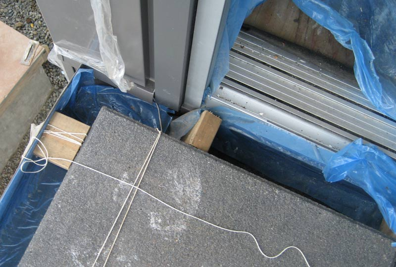 CONCRETE-PAVER-AT-SLIDER-DOOR-THRESHOLD