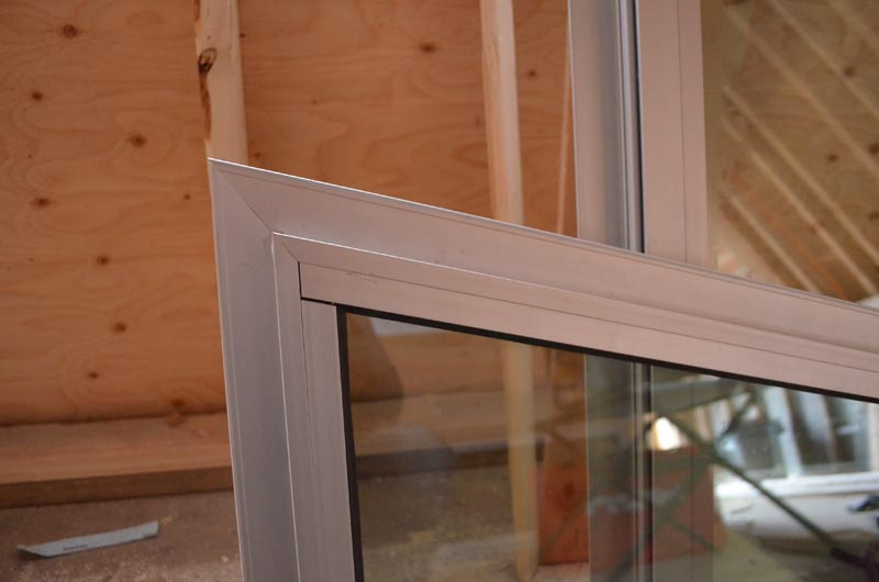 ALUMINUM-NAIL-ON-FLANGE-WINDOW-FRAME-CORNER-CLOSEUP