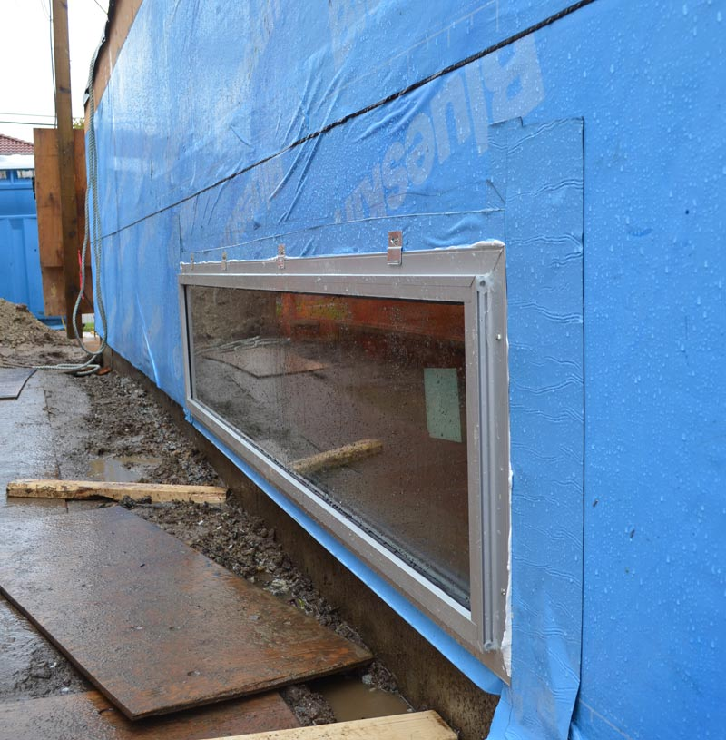 ALUMINUM-NAIL-ON-FLANGE-WINDOW-INSTALLED----VIEW-FROM-OUTSIDE-OVER-BLUSKIN
