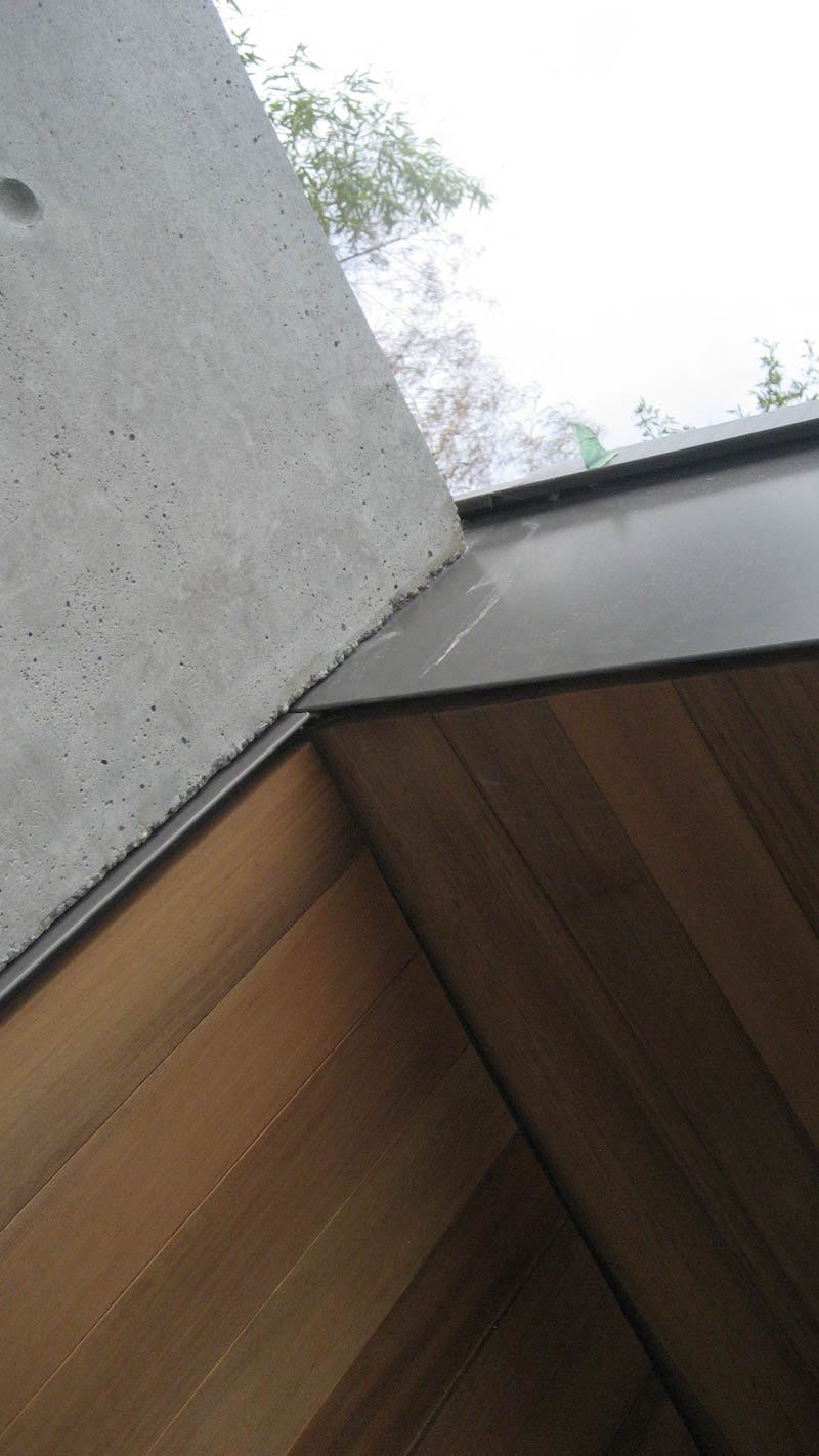 Cedar-siding-and-soffit-at-concrete-wall-and-metal-fascia