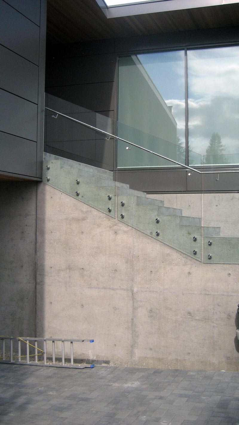 Glass-guard-attached-to-concrete-stair-with-button-attachments-2