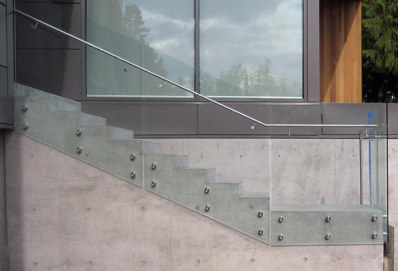 Glass-guard-attached-to-concrete-stair-with-button-attachments----in-elevation