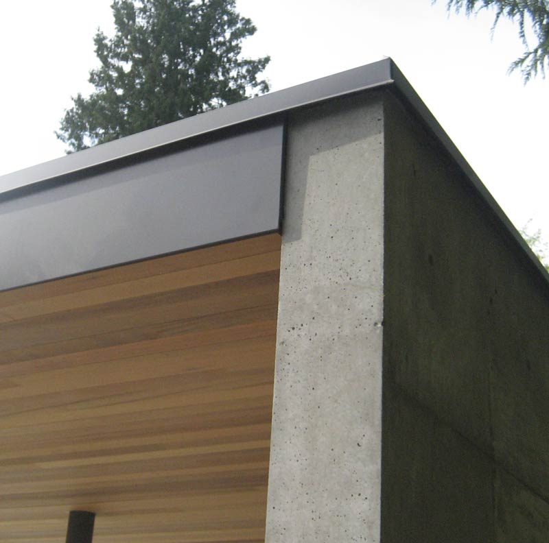 Metal-fascia-at-cedar-soffit-and-concrete-wall
